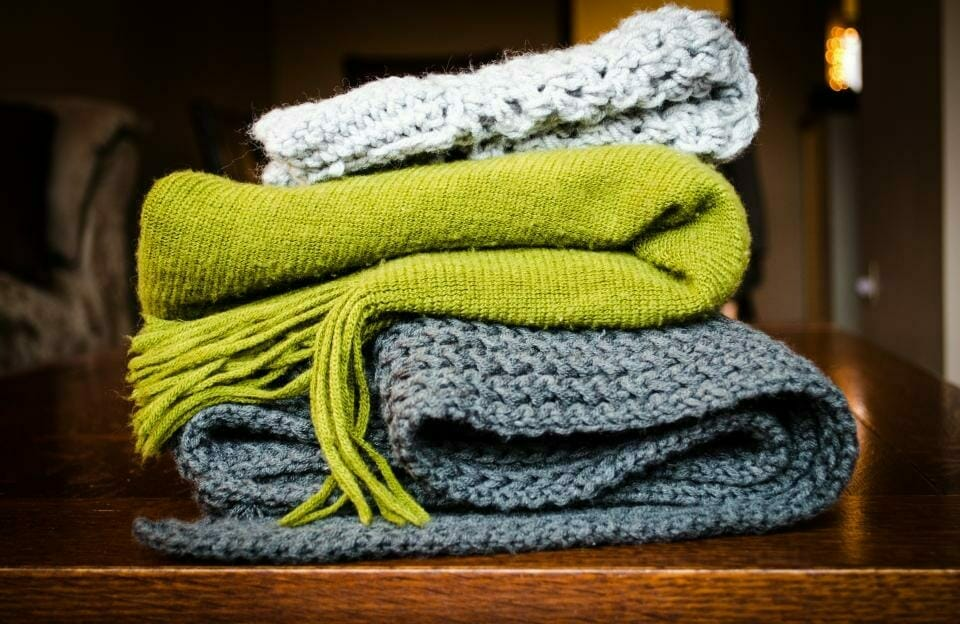 A pile of thick knits, pack at least one on an Italian vacation