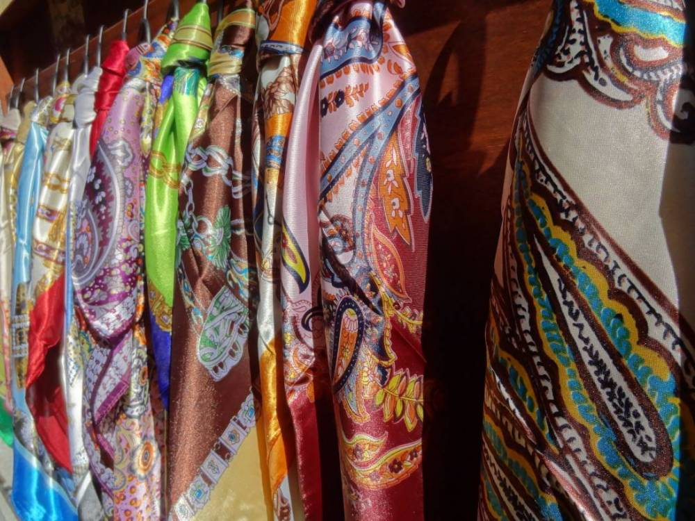 A close-up of intricate silk scarves from Lake Como