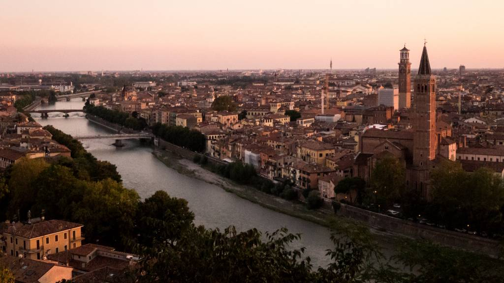 A wide angle over the city of Verona at twilight, exactly when the opera in the Verona Arena begins!