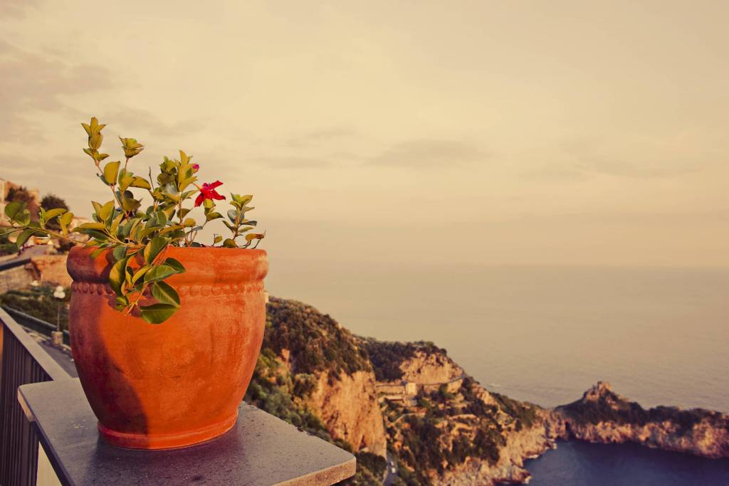 beautiful orange vase and a view of the sea from the Amalfi Coast