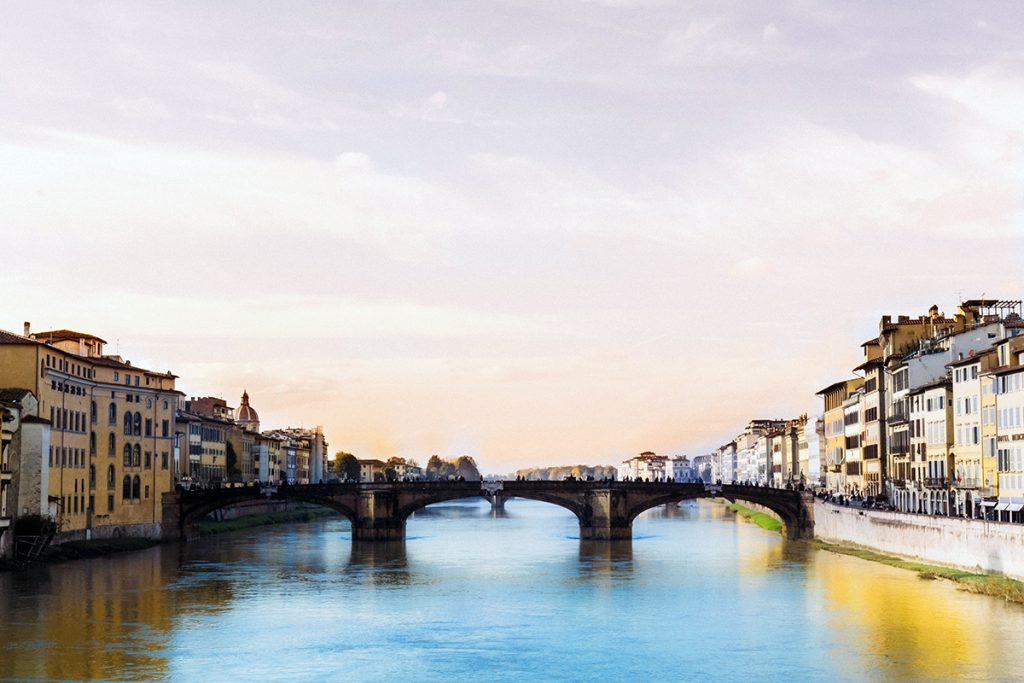 sunlight over the Arno River in Florence, Italy